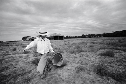 100 percent cowgirl Jess Abney dragging a bucket