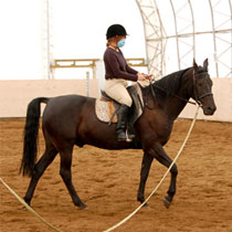 Melanie Pierson riding her horse